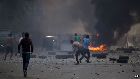 Supporters and opponents of Egypt's ousted Islamist President Mohammed Morsi clash in Cairo