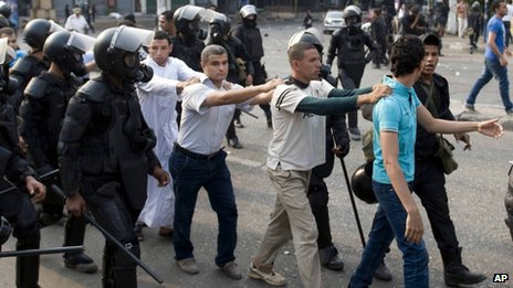 Supporters of ousted President Mohammed Morsi are detained during clashes with riot police in Cairo