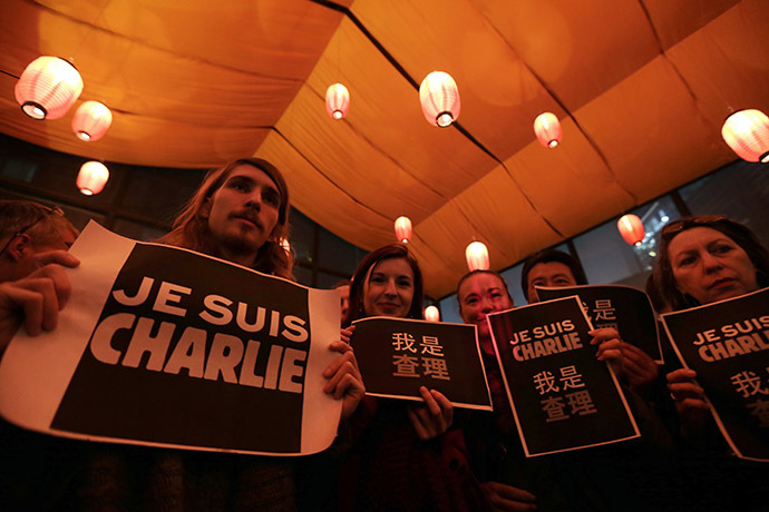 "Foreign journalists and other people hold placards that read ""I am Charlie"" during a campaign at a bookstore in Beijing January 8, 2015 for the victims of the shooting at the Paris offices of weekly newspaper Charlie Hebdo on Wednesday. (Reuters/Jason Lee)"