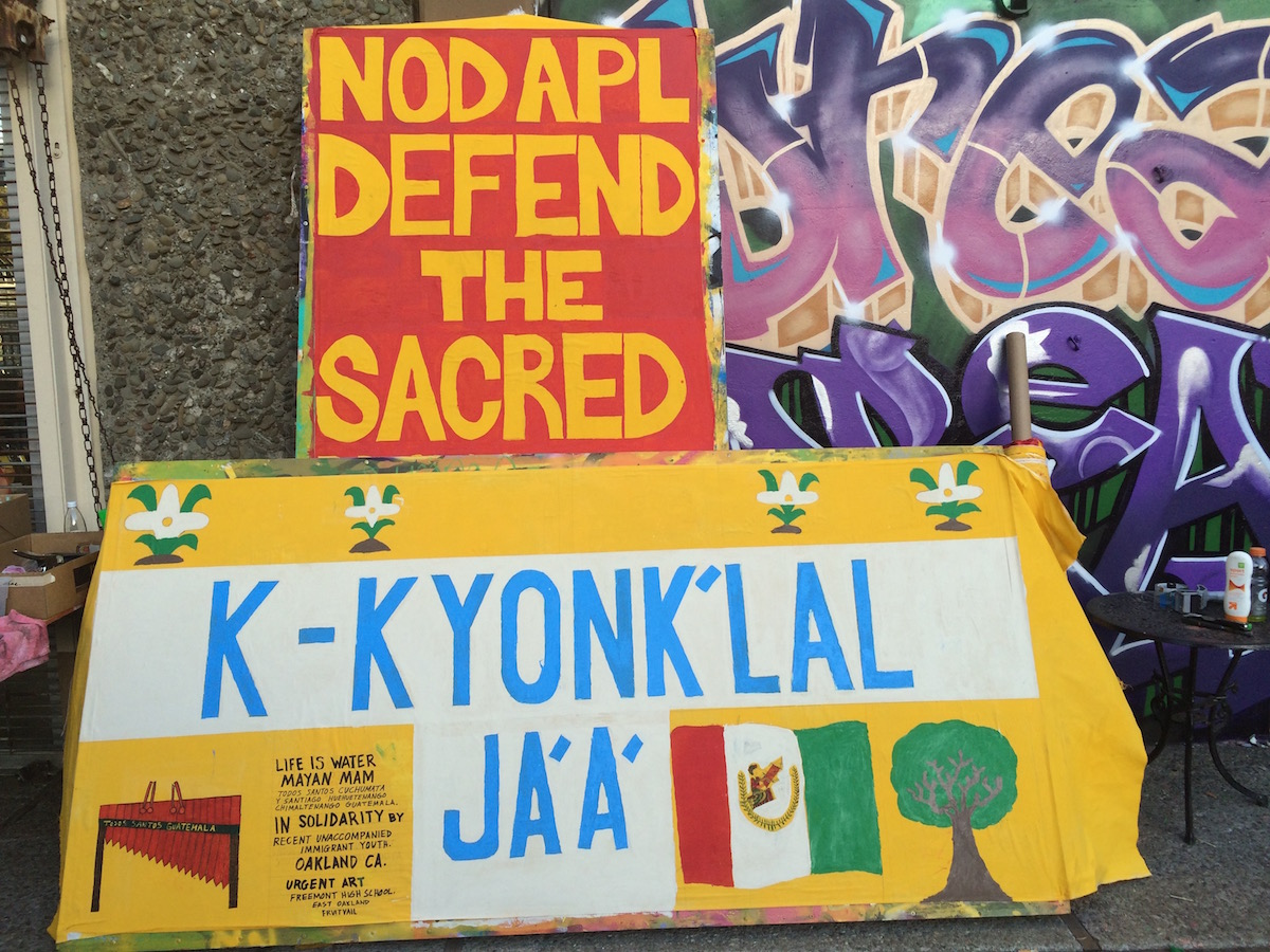 "Art build in Oakland, CA : Recent unaccompanied minors from Guatemala write ""Water is Life"" in Maya. (Photo: Nadya Tannous)"