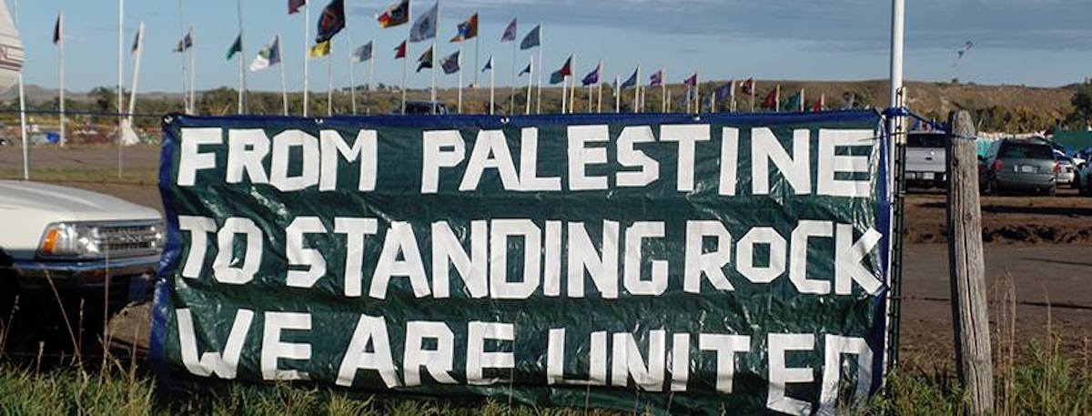 """From Palestine to Standing Rock"" banner (Photo: Haithem El-Zabri with creative help from PYM)"